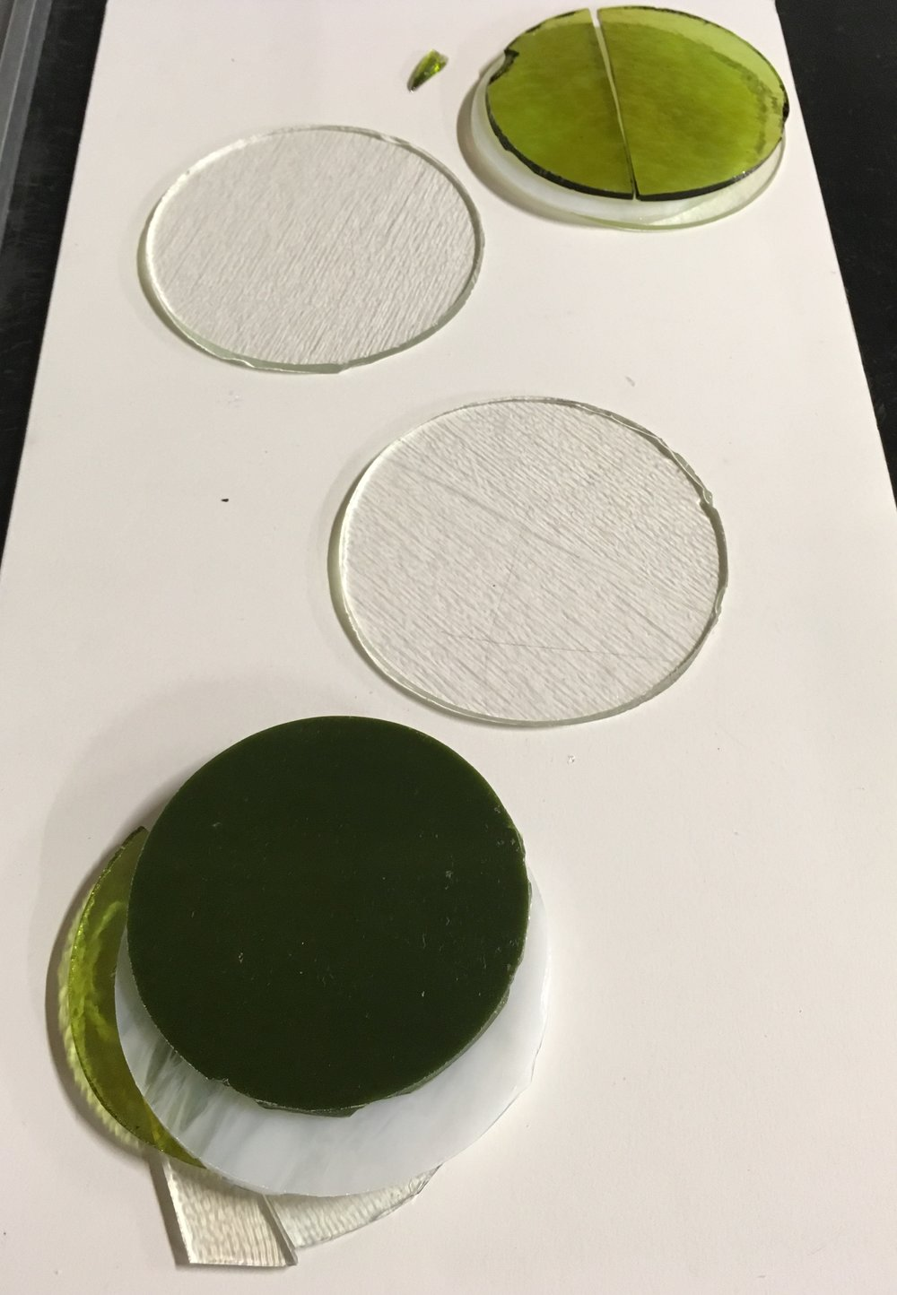 What happens when cutting circles with cold glass or not paying close attention — more cracks & uneven edges. (These were small test pieces.)