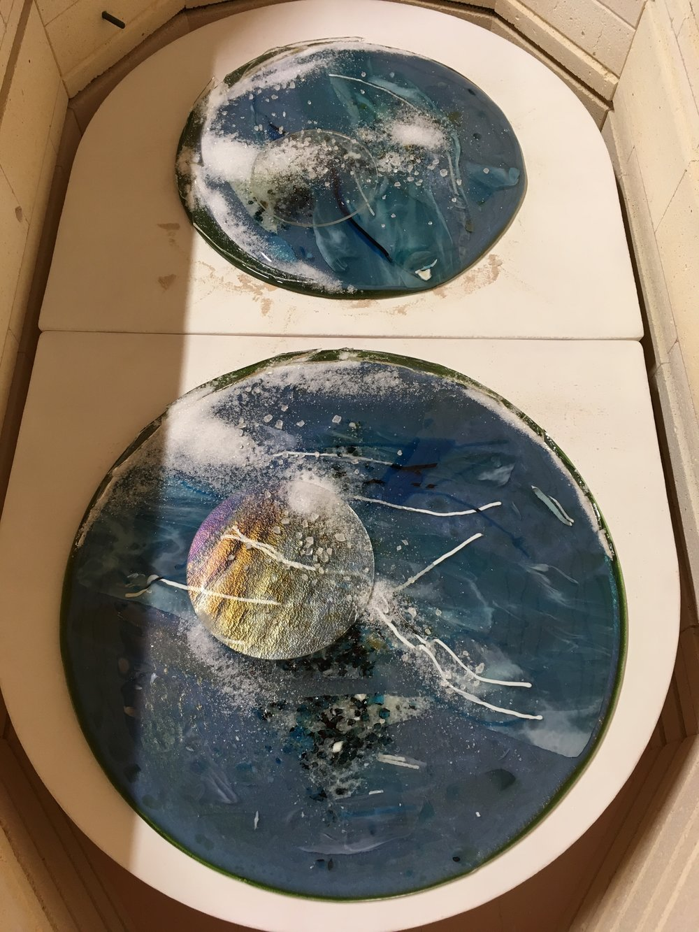 These are bird's eye view of two newer water rounds — in the kiln. (Work will debut at  McColl Center for Art + Innovation  exhibition during my residency that starts next month:)