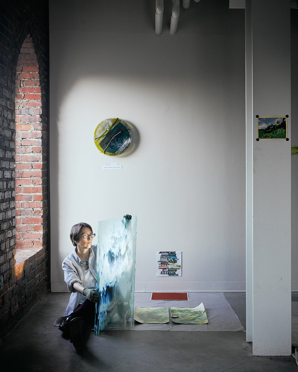 Fabulous image of me in my    McColl Center for Art + Innovation    studio by    Chris Edwards Photography   . I'm holding a sheet of    Bullseye Glass   . (The only stuff I use… it's gorgeous:) The idea was Chris Edwards'.
