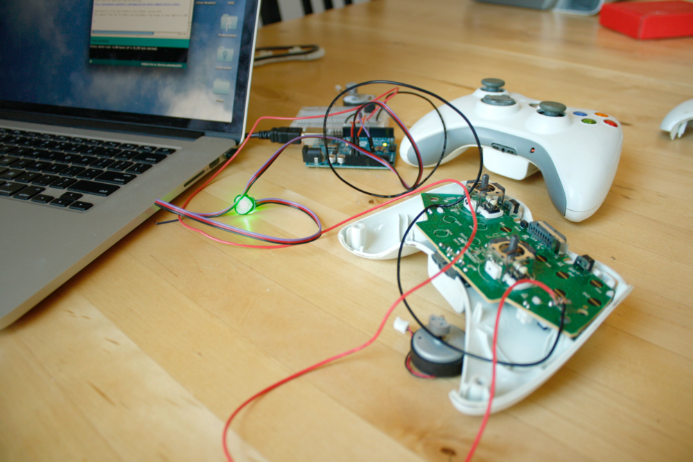 Hacking an Xbox - I prototyped a solution by modifying an xbox controller with a pulse sensor to record the gamers heart rate and provide visual and haptic feedback in response to stress during play.