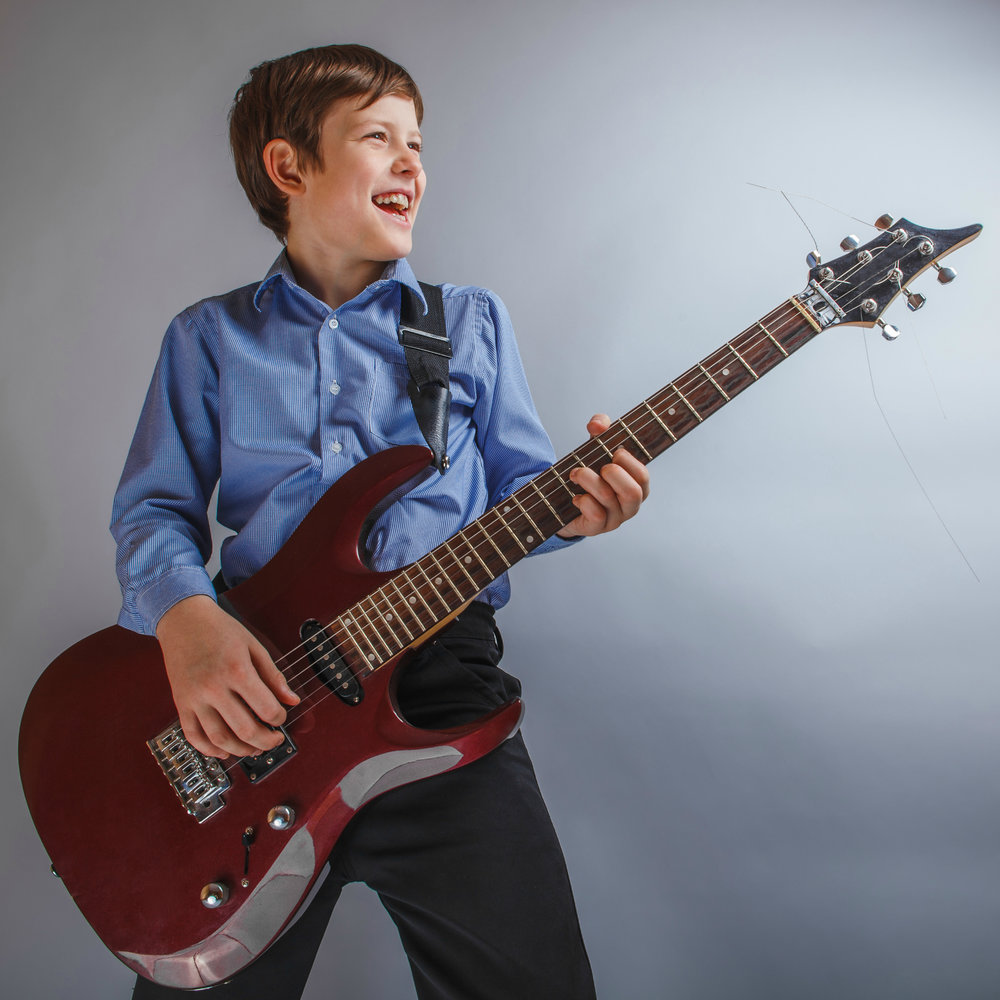Engaging Guitar Lessons - We only hire the best and brightest teachers. They don't just know guitar and bass inside and out, they know how to make lessons fun and engaging.Whether it's acoustic or electric, rock or pop, jazz or classical, our teachers are able to reach students at almost any age. And they do the driving so you don't have to!Request information below to have one of our teachers come to your home for a free trial guitar or bass lesson!