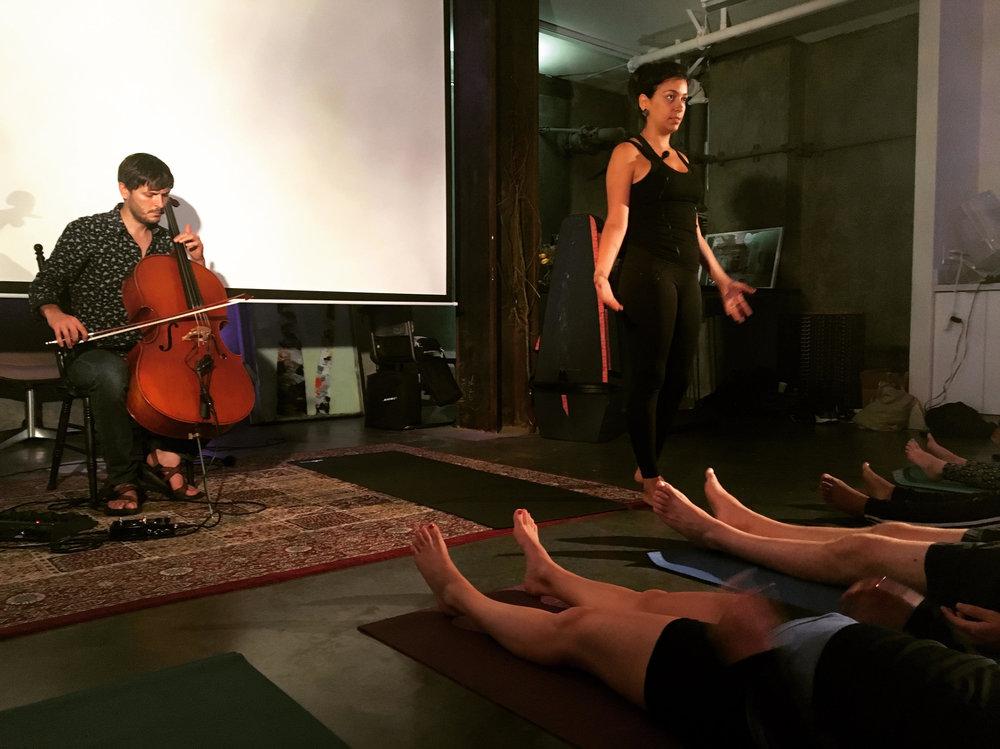 Maayan Ivgi of  Mayan Body and Soul leads a yoga class to the cello music of  Joshua McClain