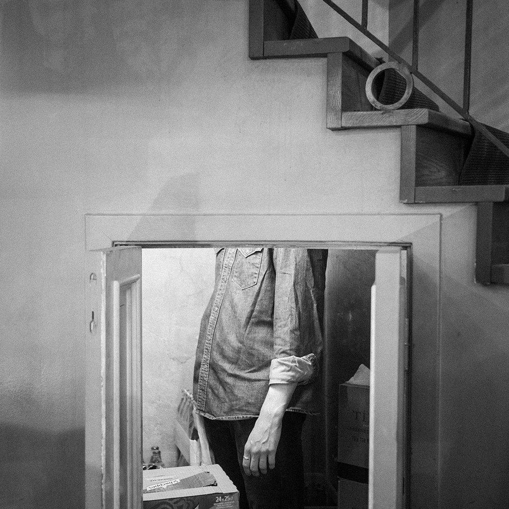 Man Under Stairs