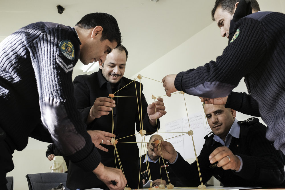 Training involves the use of adult learning techniques and activities to encourage team work