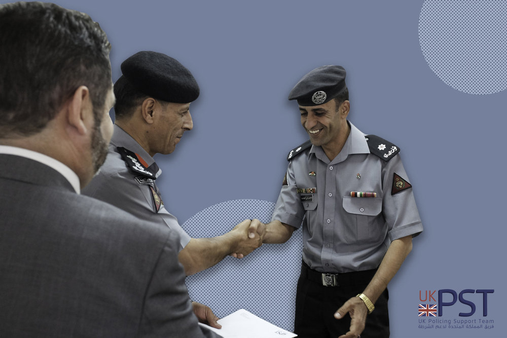 One of the participants at the second Tactical Operations Command course receives his certificate from a senior Gendarmerie commander