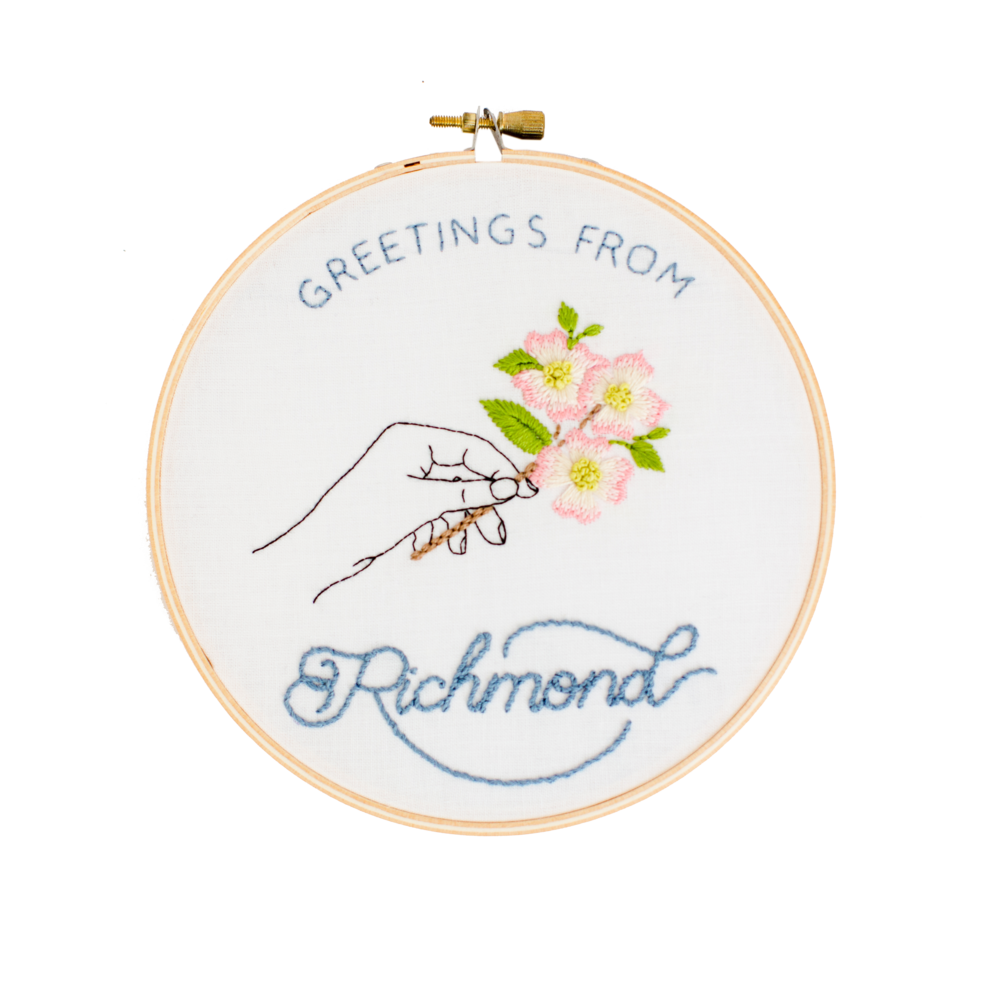 Emerald and Fig's Greeting from Richmond Hoop Art. Image of hoop with hand holding a pink and white dogwood (Virginia's state flower).