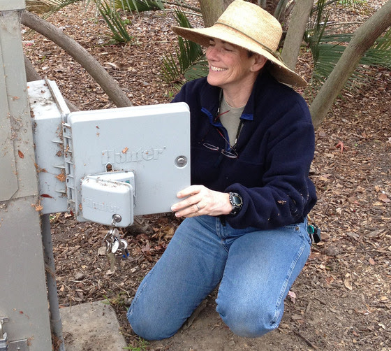 Lori Palmer with irrigation controller