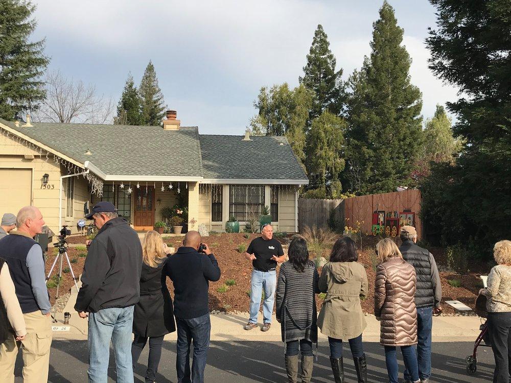 Neighbors celebrate the Nelson's new garden.