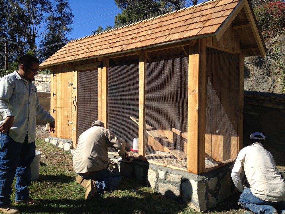 A traditional style coop with custom stone work to coordinate with existing materials.