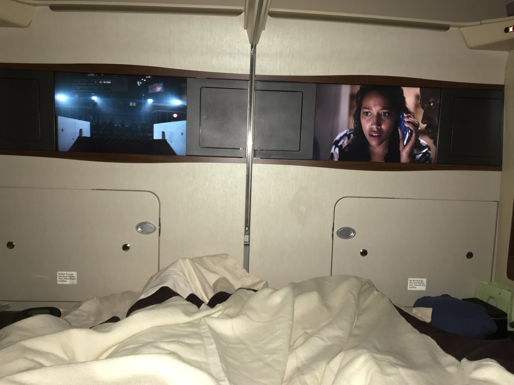 Laying in our bed , watching some movies somewhere over Asia.