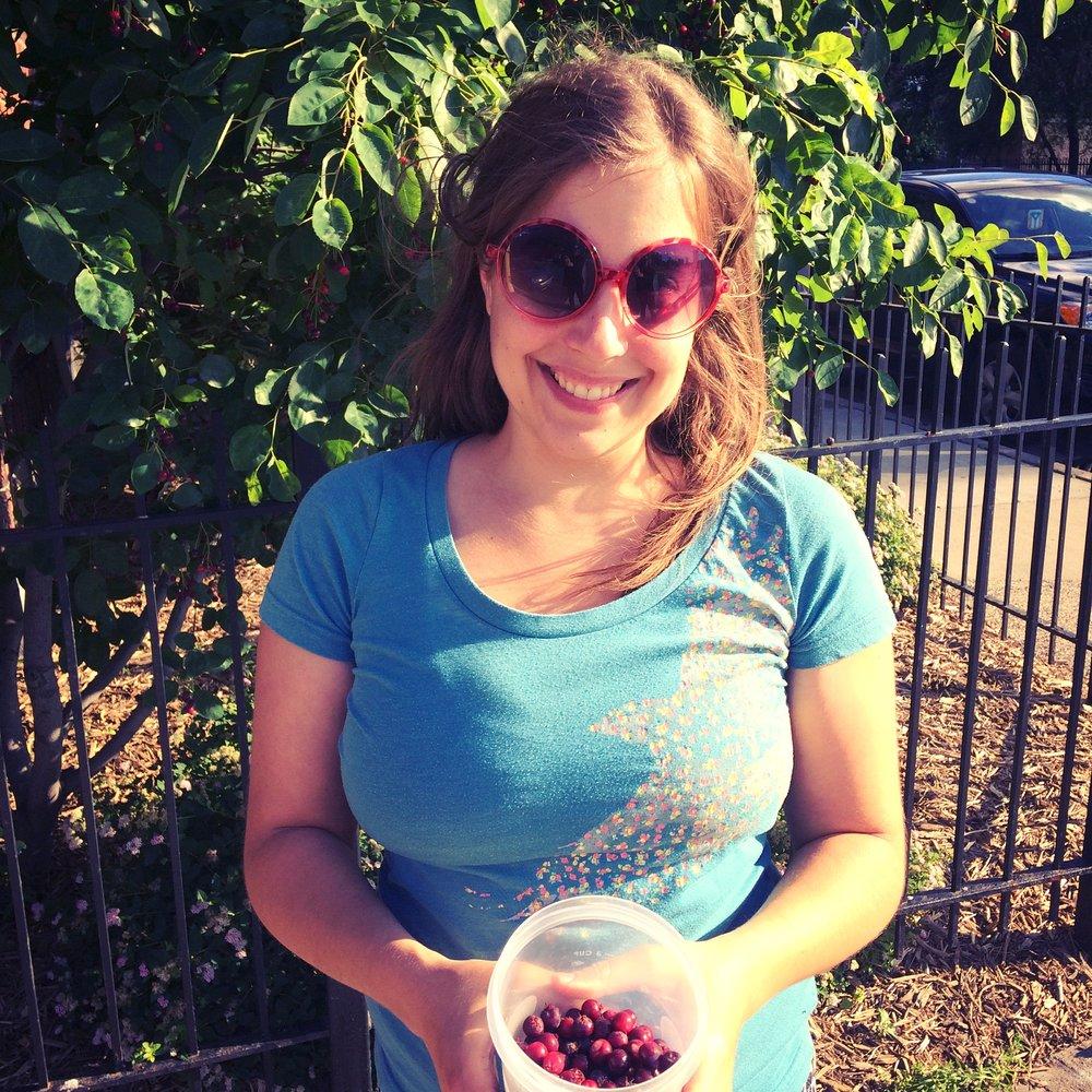 maria picking juneberries in minneapolis