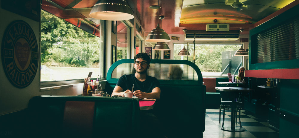 Chilling at an OK diner on the way to a gig, 2016
