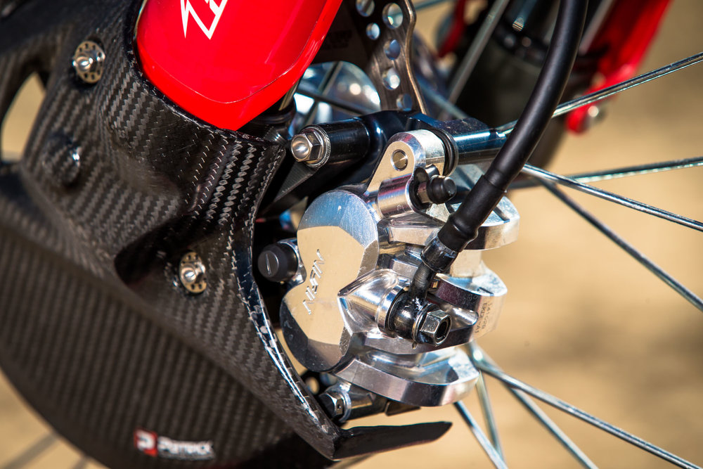A factory front Nissin brake caliper stops the Honda on a dime. However, it isn't a grabby front brake, but has more of a progressive feel to it and that invites you to go in deeper into bowl corners.
