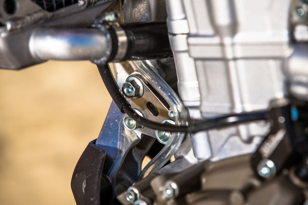 JB10 opts for the feel of the titanium front engine hanger. Although the shape is the same as the stock piece, the stiffer feel of the titanium up front helps the side to side movement of the CRF450R feel quicker/lighter.