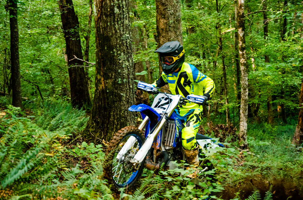 Dominic Cimino two-smoking his way around the greenery on the YZ250X.