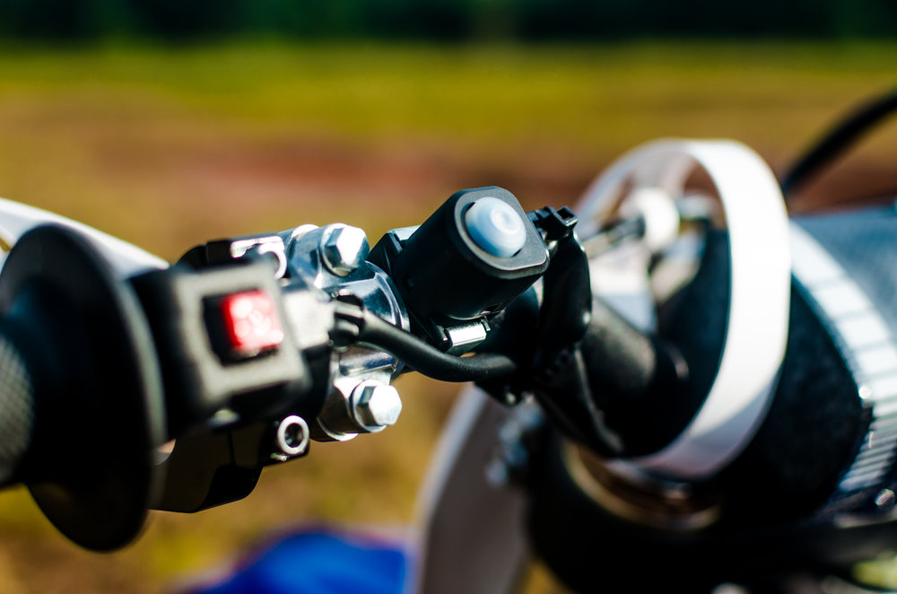 A handlebar mounted map switch that let's you go back and forth bewtween two maps while you're riding comes standard on the 2019 YZ450FX!