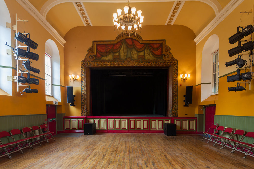 Main hall - The main hall seats up to 150 people, with fully flexible seating. The stage, audio-visual equipment and stage lighting are all available for hire- please discuss your requirements with Victoria Hall staff.