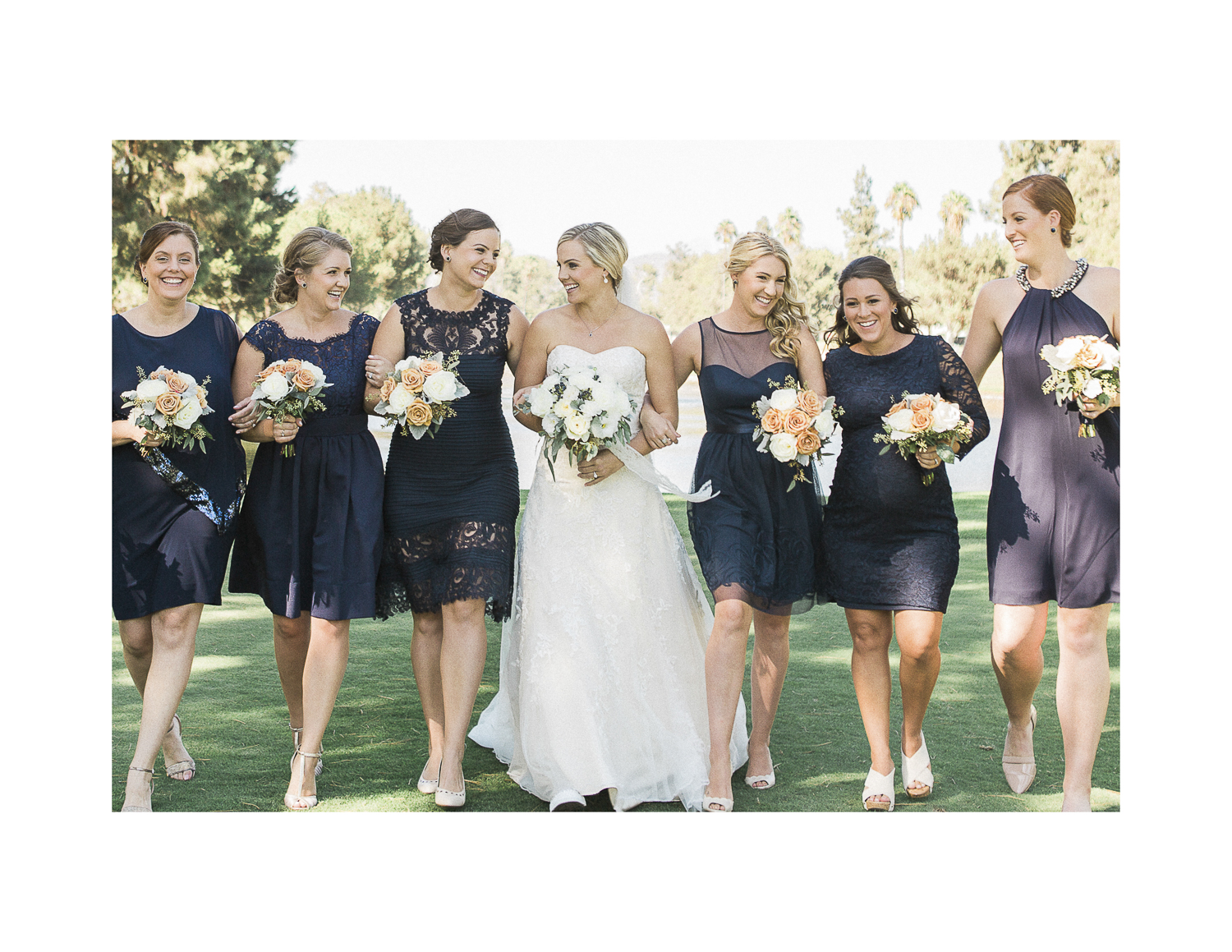 The bridesmaids wore navy mismatched dresses.