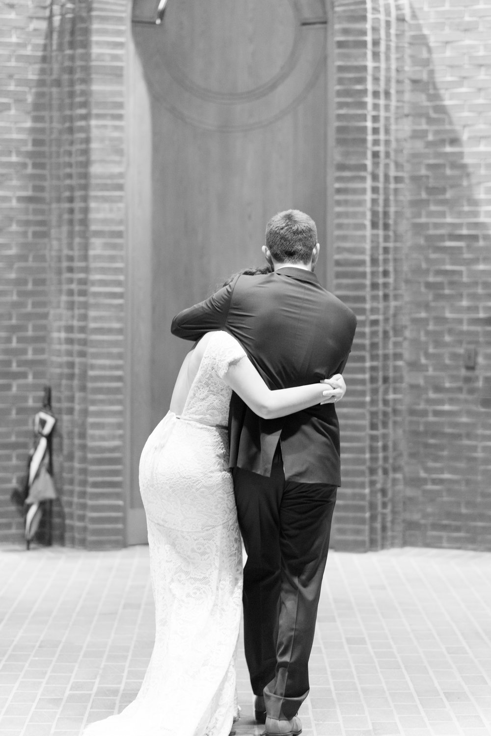 the exit; - They embraced each other as they exited the ceremony, like they both felt they had won the grand prize.