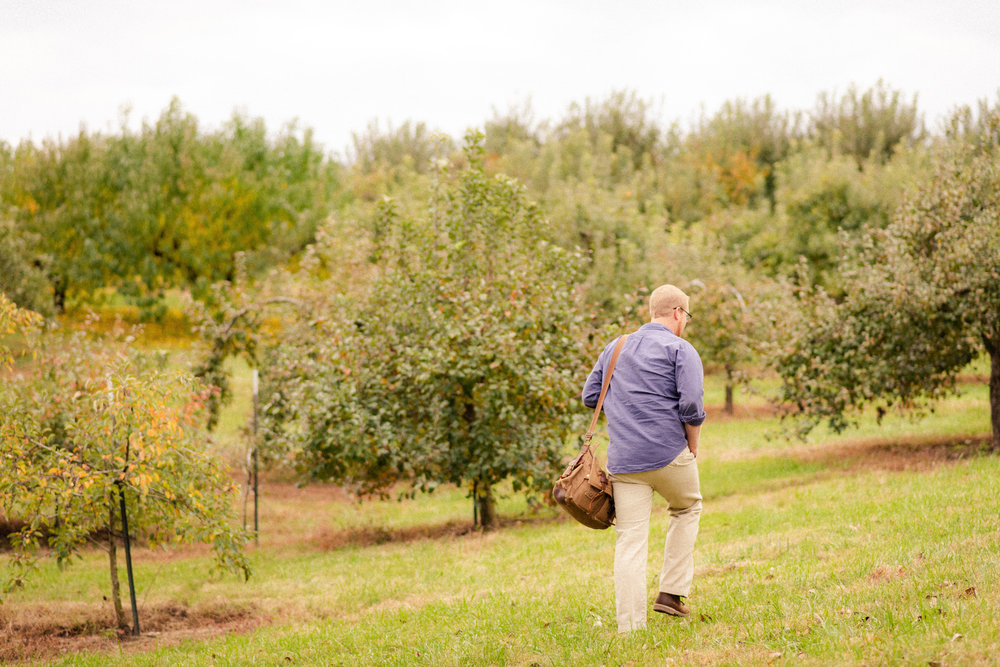 Cameron - November 2018  Here, Cam and I were scoping out the orchard I was about to take Fall Mini photos in. This photo reminds me of his dedication and compassion towards our relationship. Cam has become an important part of this journey because he knows how much it means to me. He chooses to spend his free time helping me, and I'm not sure how I landed someone so supportive and selfless in that regard. I have to pinch myself sometimes.