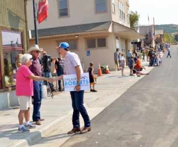 Dylan Roberts meets with the crowd at the Oak Creek Labor Day Parade.