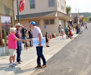 Dylan Roberts meets with the crowd at the annual Oak Creek Labor Day Parade.