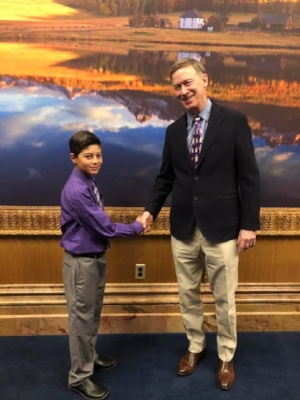 Quintin Lovato of Gypsum meets Governor John Hickenlooper after the Governor signed into law HB1286, a bill named after Quintin.