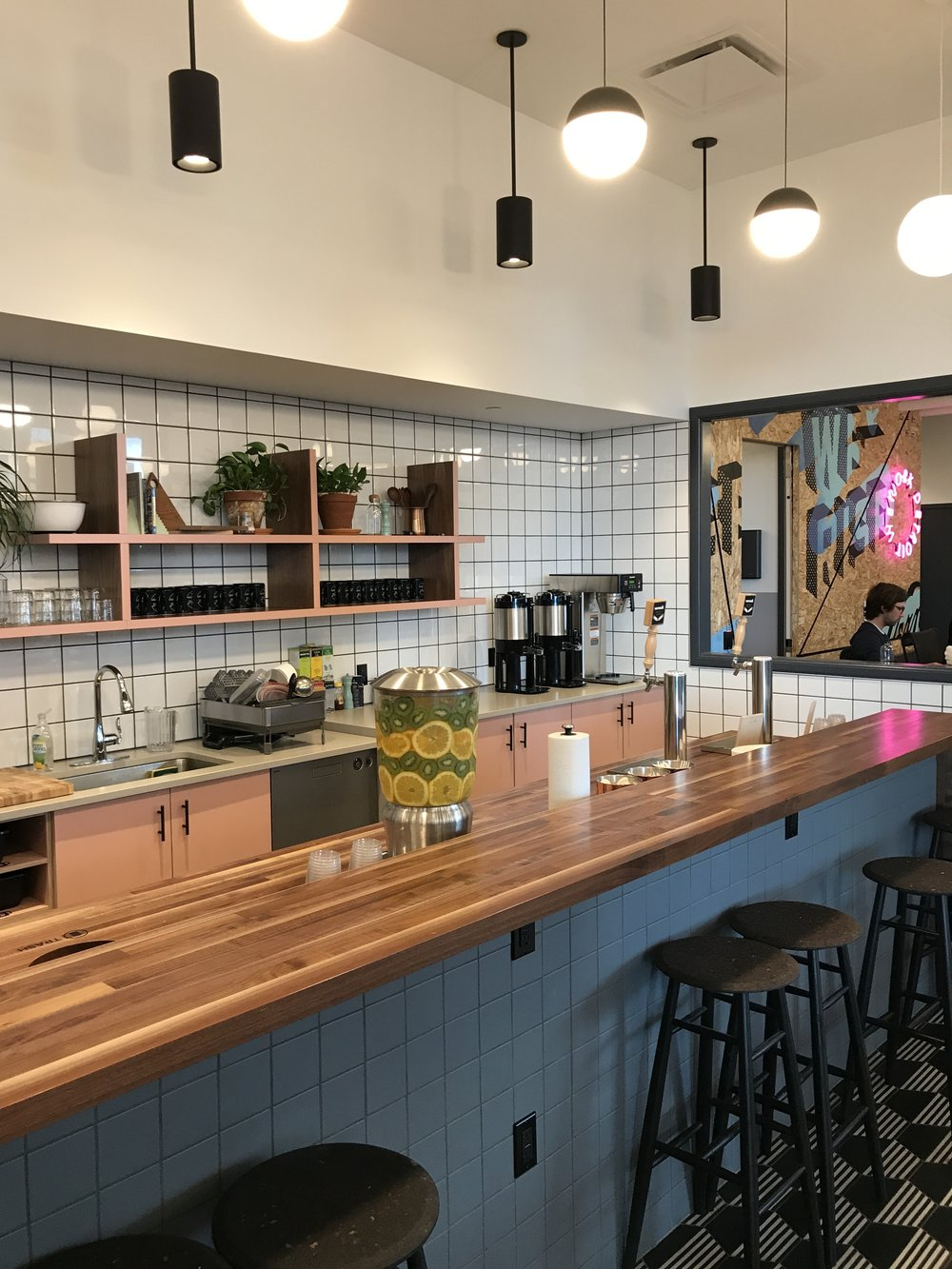 Much like people's homes, the Kitchen is an essential part of the community. Front and center, and in this particular set up – Craft Brew on tap 24/7!