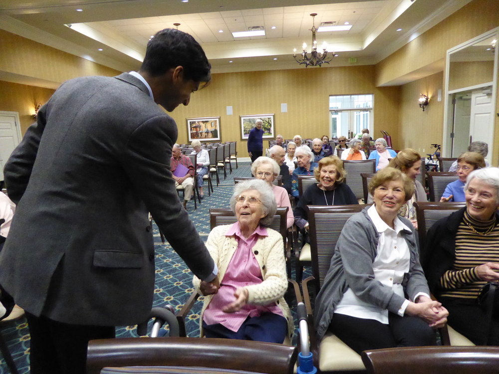 Michael Maliakel ('16 Gold) meets residents of the Marshes