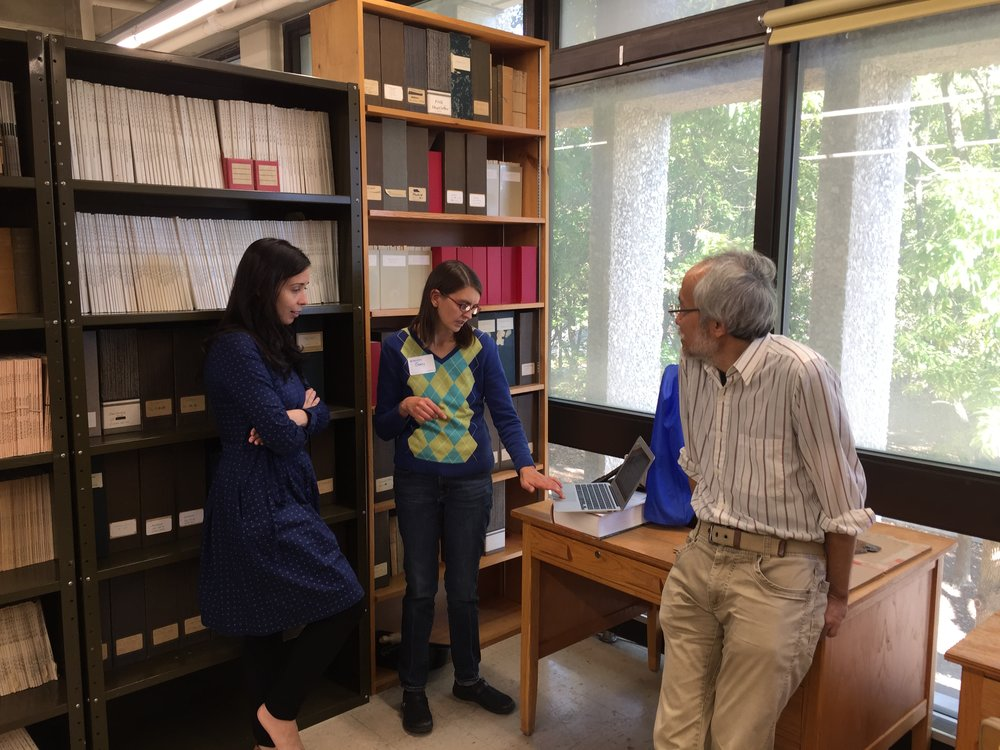 Drs. Martha Muñoz, Ginny Pannabecker, and Jim Tokuhisa engaged in discussion during the tea.