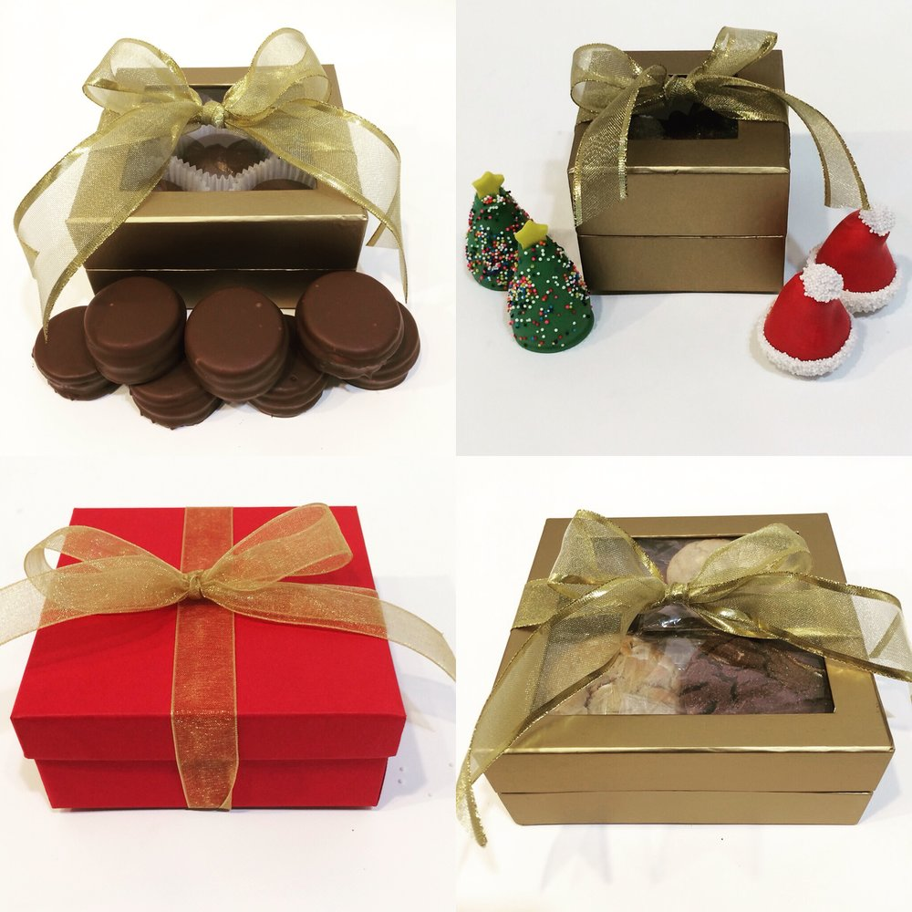 We have gifts for every budget.   From top left clockwise: Box of 10 Peanut Butter Cup Oreos $24.95 Box of 4 Hat and Tree Truffles $10.95 Box of 4 Truffles $5.95 Box of 1 dozen cookies $19.95
