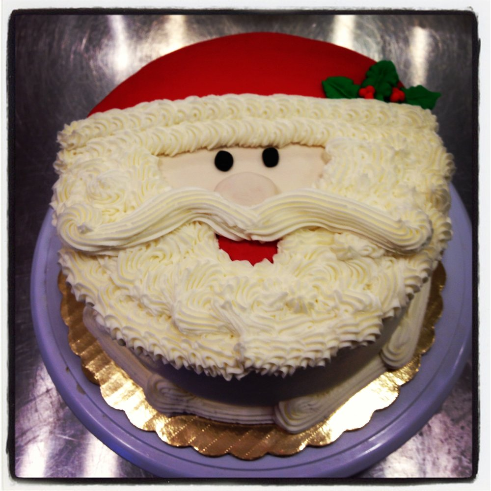 "Santa Cake Your choice of cake and filling Santa is a mixture of buttercream and fondant 6"" $35 8"" $45 10"" $65"