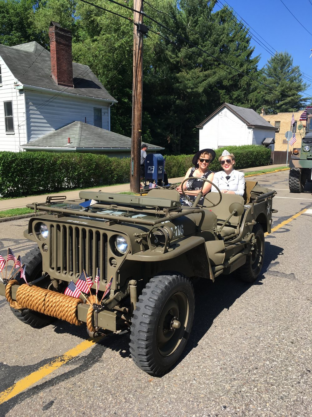 My dad owns a 1943 Willy's MB, and we have the opportunity to ride in our community parade. We reenact allied forces from World War II to honor the sacrifices of The Greatest Generation. Today, my mom dressed as a civilian, I wore an original WAVE seersucker work uniform, and my dad wore army summer khakis with the 8th service command patch. For four years now, I have had the honor of singing the national anthem at the ceremony following the parade. I hope you celebrate this day with your community and remember those that made the ultimate sacrifice defending freedom.