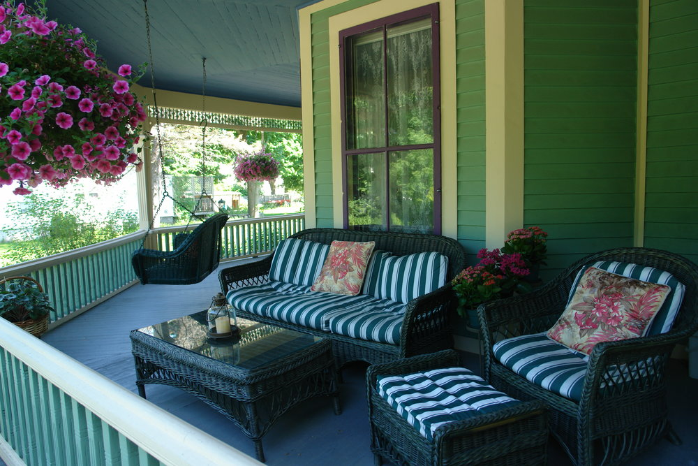 Photo pf Front Porch with wicker furniture