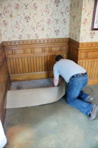 Frank starts removing the old carpet.