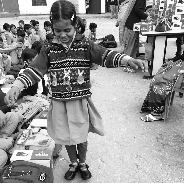 Distributing school shoes amongst the student. This is the first pair for many!