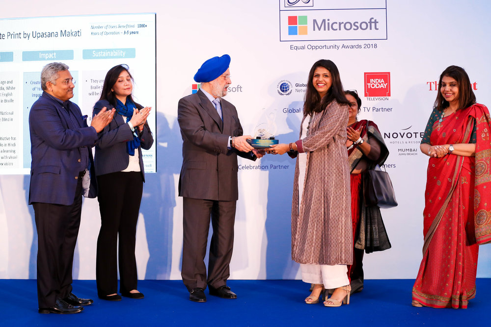 Mr. Hardeep Puri, Honorable Minister of State (INDEPENDENT CHARGE), Housing and Urban Affairs, GOVERNMENT OF INDIA HANDING OVER THE AWARD TO UPASANA MAKATI, WHITE PRINT, THE WINNER OF THE NIPMAN FOUNDATION - MICROSOFT EQUAL OPPORTUNITY AWARDS 2018 - INNOVATION (NON-TECHNOLOGY)   (Left to right: Mr. Pravin Malhotra, Trustee, Nipman Foundation, Ms. Karishma Chhabra, Senior Manager, Business Operations and Accessibility, Microsoft India, Mr. Hardeep Puri, Honorable Minister of State (INDEPENDENT CHARGE), Housing and Urban Affairs, GOVERNMENT OF INDIA, Ms. UPASANA MAKATI, Founder, WHITE PRINt, Ms. Stuti Kacker, Former Chairperson, National Commission for Protection of Child Rights, Ms. Priyanka Malhotra, Managing Trustee, Nipman Foundation