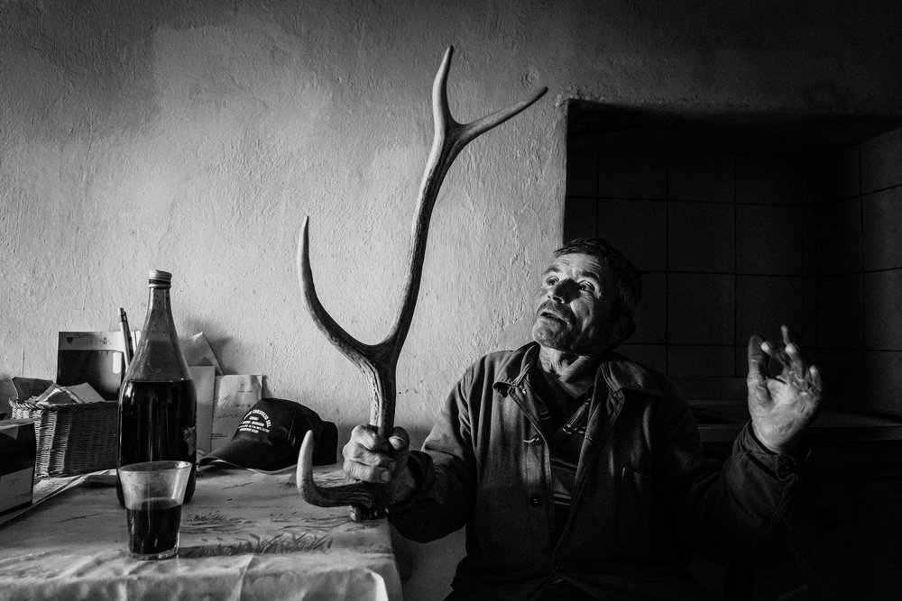 Agnone (IS), Italy - February 2016. Angiolino del Papa inside his house with deer's horns in his hands. He found the horns in the woods during the long hours spent on the grazing land with cattle in summer.