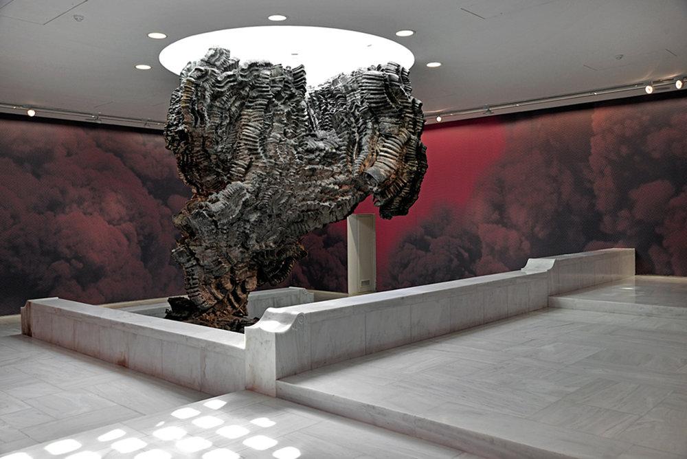 Mise-en-Scène_Red Smoke 2015  Digital print on vinyl Sculpture: Roberto Cuoghi, Belinda, 2013 Photos: Fanis Vlastaras & Rebecca Constantopoulo