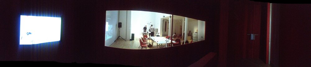 Observatory  Projection of meeting table activity, two way mirror 'cinemascope' viewing window and sound via speakers.