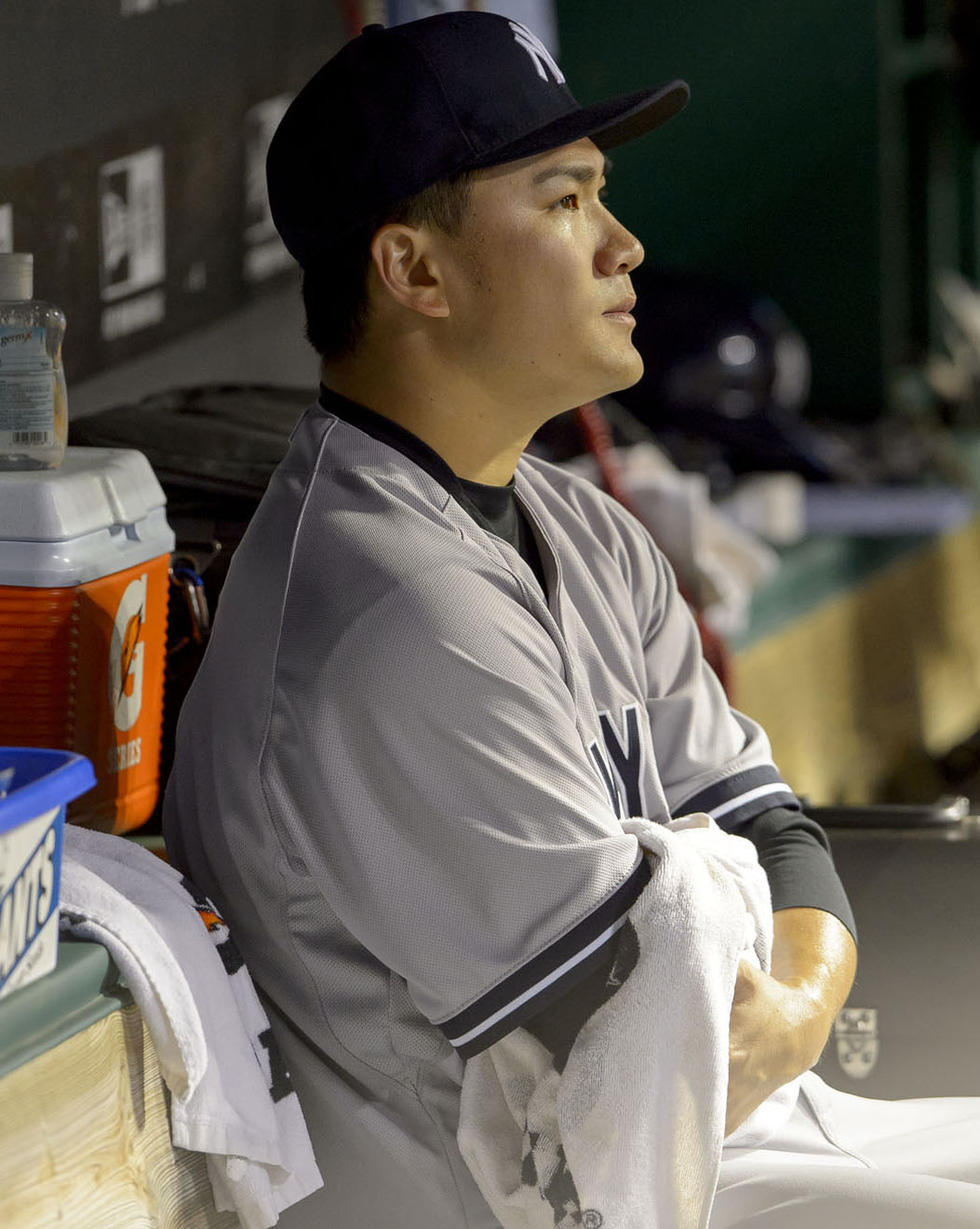 Starting pitcher Masahiro Tanaka #19 of the New York Yankees sits in the dugout after leaving the game during the seventh inning against the Cleveland Indians on July 8th, 2014
