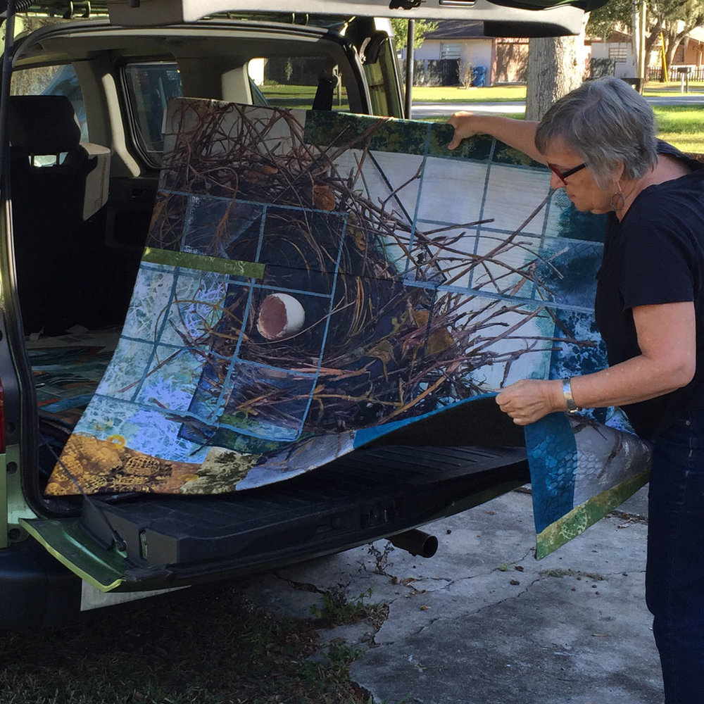 bobbibaughstudio-art-quilt-loading-into-car.jpg