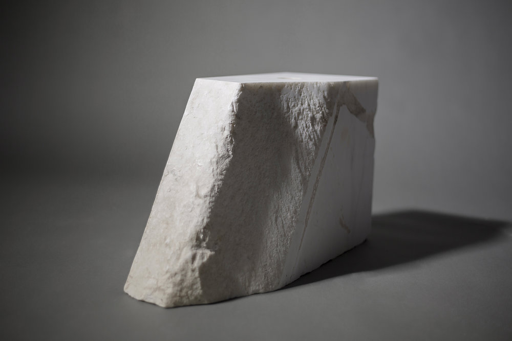 The perception of something's or someones' value depends on what we choose to pay attention to - This is an irregularly-shaped white marble base from Carrara.It's imperfect. An error.orThis is a unique fragment of Apuan Alps, generated million years ago by the movements of the earth's crust. Before it became marble, it had been a coral reef in the warm tropical sea of the continent Pangea, in the era when dinosaurs dominated dry land.