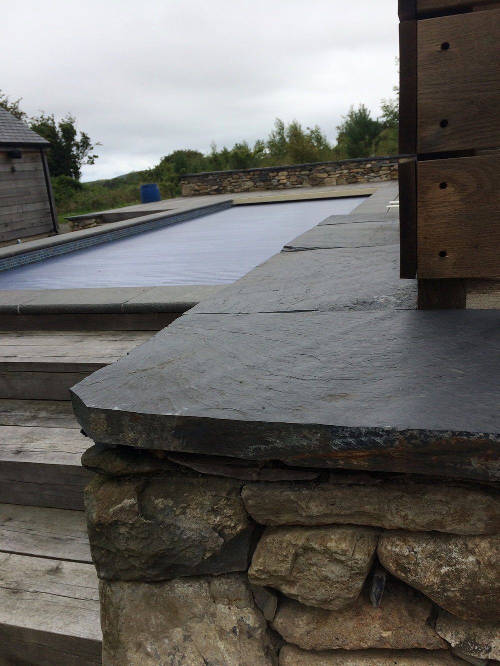 Riven top natural edge Welsh slate coping