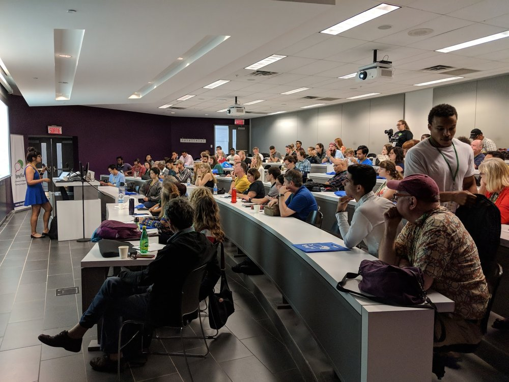 Giving my talk — Thanks everyone for joining me! Photo courtesy of LangFest/Bahaa Hussein