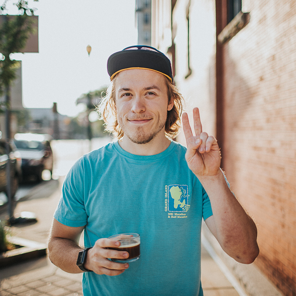 Meet Isaac - You'll catch a glimpse of him in the shop pretty much every day first thing in the morning and it's safe to say he gets the free cup of coffee most days. He likes to participate in dangerous and challenging activities and recently ran the Grand Island trail marathon. Isaac's order: an americano and a tasty pour over.