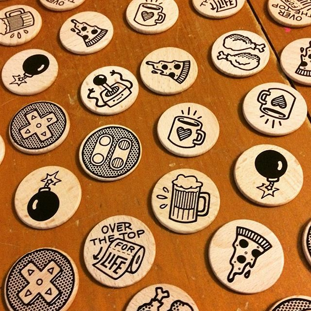 I started doodling a bunch of junk in illustrator and now I'm printing them for magnets! Made a custom press pallet and everything D: So much fun! - - - #screenprinting #diy #blackink #pizza #coffee #chicken #bomb #videogames #snes #illustration #doodle