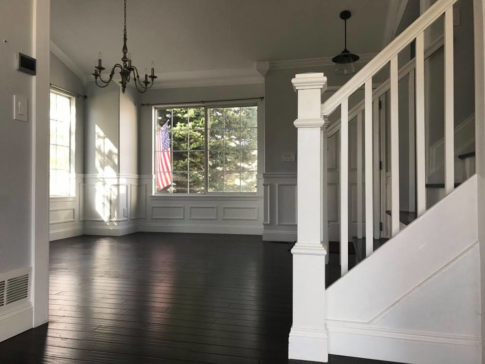 Custom stair banaster and trim work, painting, baseboards, crown molding and lighting