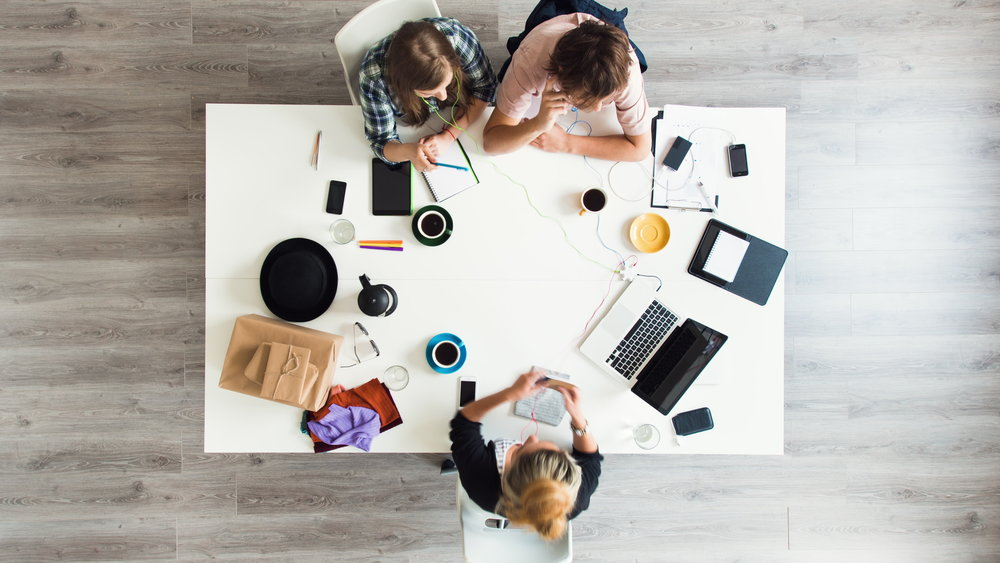stock-footage-mixed-race-group-of-people-aerial-view-timelapse-hipster-office-small-business-start-up-company1.jpg