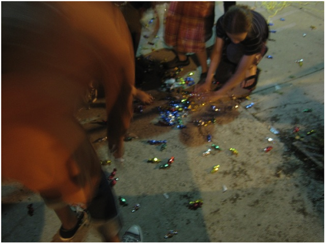 The same evening that the mole was made, artist  Samuel Sotello-Avila  invited members of the public to break his  Minimalist Pinata . The silver-painted rectangular form was filled with candies identical to the one's found in Felix Gonzalez-Torres' famous   Untitled (portrait of Ross in L.A.)   of 1991. This event took place immediately outside of the Cobalt Studio and included both passerby and gallery attendees of all ages.